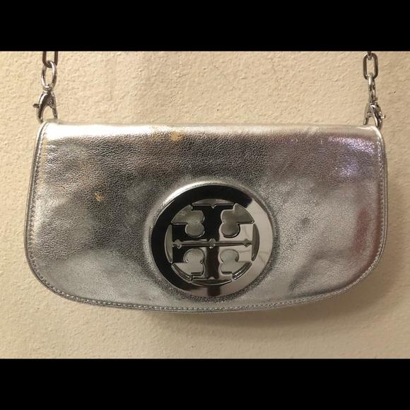 1706836f7aa ... Tory Burch Metallic Logo Clutch. M 5b1308db8ad2f9d55e0ae728